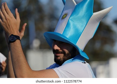 ST. PETERSBURG, RUSSIA - JUNE 26, 2018: Argentinian football fan in a top hat at Saint Petersburg stadium during FIFA World Cup 2018 before the match Argentina - Nigeria. Argentina won 2-1