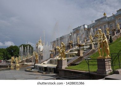 St Petersburg, Russia - June 26, 2017: People enjoying the Palace Park of Peterhof in a sunny day, Peterhof Palace and the Grand Cascade of fountain in Peterhof, Saint Petersburg, Russia