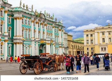 St. Petersburg, Russia - June 26, 2019: Horse-drawn carriage in front of Winter Palace (Hermitage Museum) on Palace Square in Saint Petersburg, Russia
