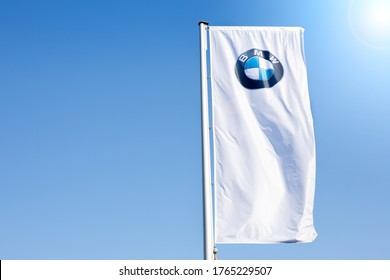 St. Petersburg, Russia June 26, 2020. a white flag with a logo BMW against a blue sky flutters in the wind on a clear sunny day