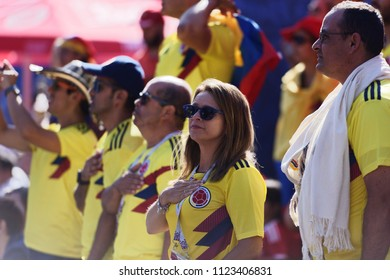 ST. PETERSBURG, RUSSIA - JUNE 28, 2018: Colombian football fans singing the national anthem at FIFA Fan Fest during the FIFA World Cup 2018 match Colombia vs Senegal. Colombia won 1-0