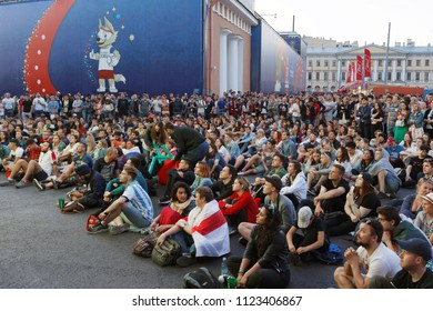 ST. PETERSBURG, RUSSIA - JUNE 28, 2018: Football fans watch the game at FIFA Fan Fest in Saint Petersburg during the FIFA World Cup 2018 match Belgium vs England. Belgium won 1-0