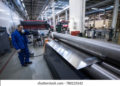St. Petersburg, Russia - June 29, 2016: Plate rolling machine. The process of manufacturing a bodywork for a vehicle. The  operator controls the quality.