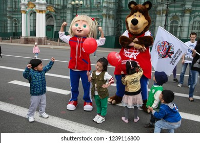 St. Petersburg, Russia - June 8, 2013: The mummers animated hero  Russian TV series Masha and the Bear in the city center entertains city residents and tourists. It is photographed with those who wish