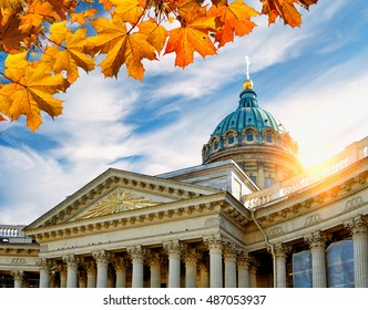 St Petersburg, Russia - Kazan Cathedral framed by maple leaves in at the autumn sunset. Soft focus applied