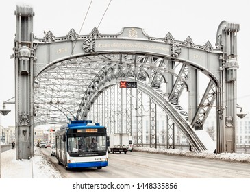 St. Petersburg / Russia - March 08 2019: Trolley bus (modern city transport vehicle) crossing the The Bridge of Peter the Great. Close Up View of Trolleybus.