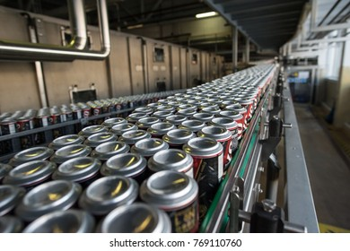 St. Petersburg, Russia - March 1, 2016: The production line of the brewing company. Automatic conveyor plant. Spilling beer in aluminum jars