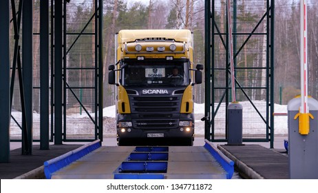 St. Petersburg, Russia - March 22, 2019: The barrier gate of the customs post is open. A Scania wagon enters the weighing control platform.