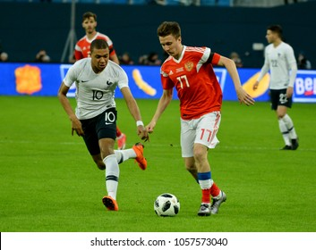 St Petersburg, Russia - March 27, 2018. Russian midfielder Aleksandr Golovin against French striker Kylian Mbappe during international test match Russia vs France in St Petersburg.