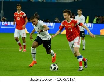 St Petersburg, Russia - March 27, 2018. Russian midfielder Aleksandr Golovin against French striker Kylian Mbappe during international test match Russia vs France in St Petersburg.