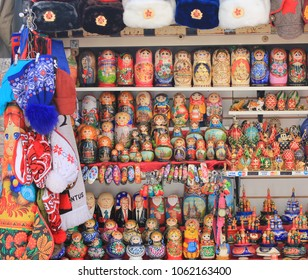 ST. PETERSBURG, RUSSIA - MARCH 28, 2018: Gift Shop Window Stall with Traditional Russian Souvenirs. Colorful Nesting Matryoshka Dolls and Ushanka Hats in Row on Shelves. Souvenir Store Display Image.