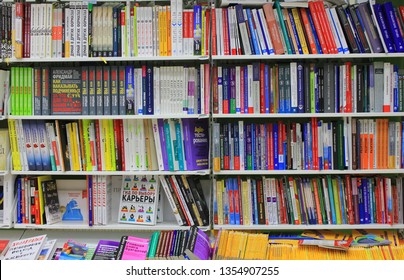 St. Petersburg, Russia - March 31, 2019: Rows of books on shelves for sale at book store. Modern retail bookseller shop interior with many educational and fiction literature and books on shelves
