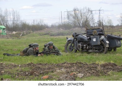 ST. PETERSBURG, RUSSIA - MAY 05, 2015: Sticking German motorcyclists. The reconstruction period of the Second world war
