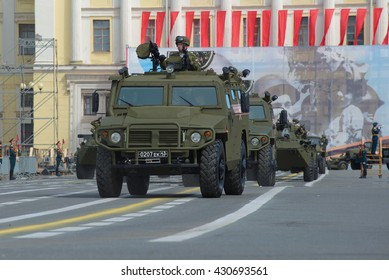 """ST. PETERSBURG, RUSSIA - MAY 05, 2015: Multi-purpose armored vehicle """"Tiger"""" at the Palace square for the rehearsal of parade in honor of Victory Day"""