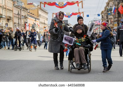 ST PETERSBURG, RUSSIA - May 09, 2017: People take part in Immortal regiment parade on Nevsky Prospect during Victory Day celebration.