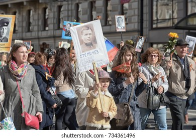 ST PETERSBURG, RUSSIA - May 09, 2015: People take part in Immortal regiment parade on Nevsky Prospect during Victory Day celebration.
