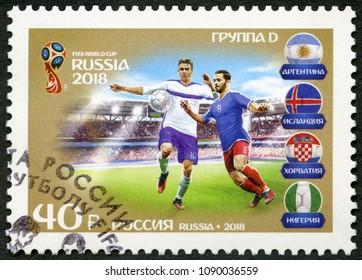 ST. PETERSBURG, RUSSIA - MAY 10, 2018: A stamp printed in Russia shows footballers, Group D, series Participating Teams, 2018 Football World Cup Russia, 2018