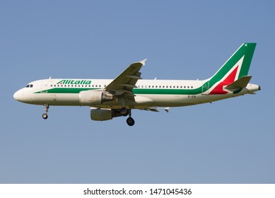 ST. PETERSBURG, RUSSIA - MAY 13, 2019: The Airbus A320 (EI-EIE) of Alitalia airline close up against the background of the blue sky. Profile view