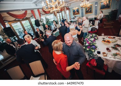 ST PETERSBURG, RUSSIA - MAY 17, 2016: Restaurant Celebration Event VIP Banquet. People Celebrating Banquette in Restaurant Showing Emotions and Make Compliments