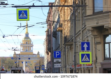 ST. PETERSBURG, RUSSIA - MAY 19, 2018: Gorokhovaya Street and Admiralty Building Tower View. Busy Russian Downtown Street in Saint Petersburg City with Many Street and Traffic Signs Close Up View.