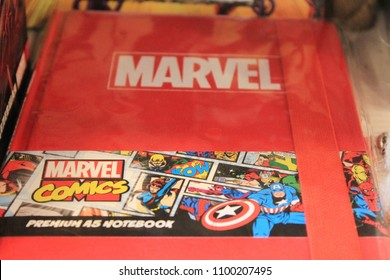 ST. PETERSBURG, RUSSIA - MAY 19, 2018: Marvel Themed Comic Book Close Up View. Red Notebook with Marvel Heroes Captain America, Wonder Woman, Spider Man on Shelf at Book Store for Sale.