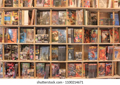 ST. PETERSBURG, RUSSIA - MAY 19, 2018: Comic Book Shop Interior Design with Comic Magazines on Shelves. Variety of Superheroes Comic Books for Sale at New Modern Cozy Bookstore Close Up View.