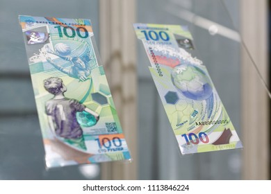 """ST. PETERSBURG, RUSSIA - MAY 23, 2018: Commemorative 100 rubles banknotes for FIFA World Cup Russia 2018 exposed in the exhibition """"1818+. Two hundreds years of Goznak's history"""""""
