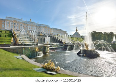 St. Petersburg, Russia — May 24, 2018: The main fountain with Samson in front of the cascades of waterfalls and the palace in Peterhof