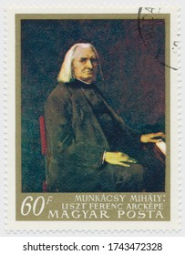 ST. PETERSBURG, RUSSIA - MAY 28, 2020: A postmark printed in HUNGARY, shows portrait of  Franz Liszt by Mihaly Munkacsi (1844-1900), circa 1967