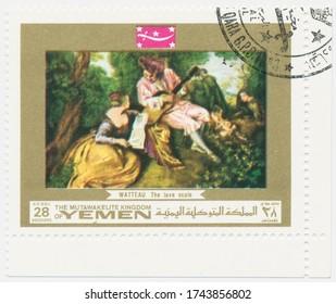 ST. PETERSBURG, RUSSIA - MAY 28, 2020: A postmark printed in MUTAWAKKILITE KINGDOM OF YEMEN, shows painting La Gamme d amour (The Scale of Love), by Antoine Watteau, circa 1969