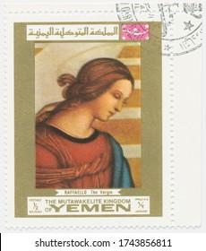 ST. PETERSBURG, RUSSIA - MAY 28, 2020: A postmark printed in MUTAWAKKILITE KINGDOM OF YEMEN, shows painting Virgin Mary, by Raphael, circa 1969