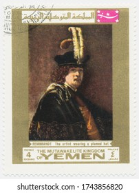 ST. PETERSBURG, RUSSIA - MAY 28, 2020: A postmark printed in MUTAWAKKILITE KINGDOM OF YEMEN, shows painting Rembrandt self-portrait with a feather hat, circa 1969