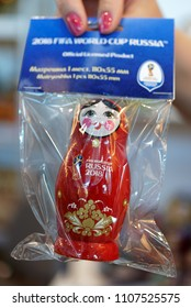 ST. PETERSBURG, RUSSIA - MAY 31, 2018: Official Khokhloma painted souvenirs of FIFA World Cup 2018 presented on the fair Nevsky Larets. Khokhloma is a Russian wood painting handicraft style