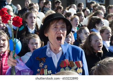 St. Petersburg, Russia - May 5, 2017: International patriotic action dedicated to the participants of the Second World War. Procession of people with portraits of their descendants of war veterans.