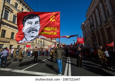 ST. PETERSBURG, RUSSIA - MAY 9, 2018: Communist party is involved during action Immortal Regiment march during the Victory Day celebrations. On the banner photo of Joseph Stalin.