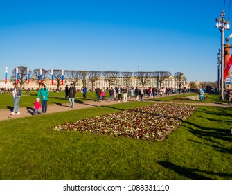 ST. PETERSBURG, RUSSIA - MAY 9, 2018: People on Birzhevaya Ploshchad (Exchange Square) on Vasilyevsky Island. Celebrations of Victory Day (commemoration of the surrender of Nazi Germany in 1945).