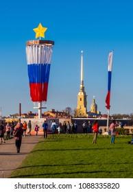 ST. PETERSBURG, RUSSIA - MAY 9, 2018: People on Birzhevaya Ploshchad (Exchange Square) on Vasilyevsky Island. Celebrations of Victory Day (commemoration of the surrender of Nazi Germany in 1945).