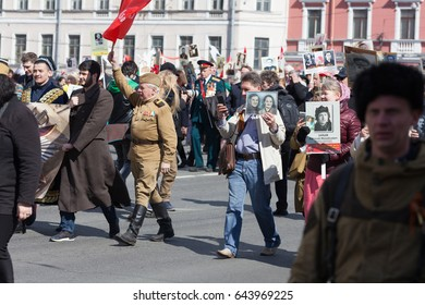 ST. PETERSBURG, RUSSIA - MAY 9, 2017: Action Immortal regiment on Nevsky Prospekt on celebration of 72 anniv Victory day on WWII, circa 2017