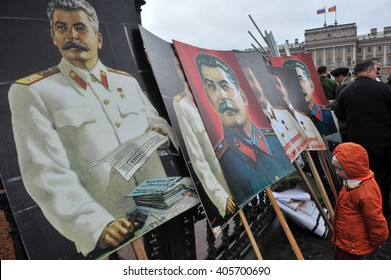 ST. PETERSBURG, RUSSIA - MAY1: Portraits of Russian dictator Joseph Stalin at the fence of the monument to the Russian Tsar Nicholas 1 during a May Day demonstration in May 1, 2010