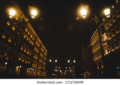 St. Petersburg, Russia - November 15, 2019: Night St. Petersburg lit with the dim yellow light of street lamps, Russia
