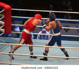 St. Petersburg, Russia, November 22, 2016 Youth World Boxing Championship men. Boxing match attack