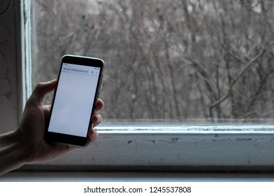 St. Petersburg, Russia, November 24 2018. address bar with twitter.com. smartphone screen on the background of the window