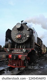 """St. Petersburg, Russia, November 30, 2018  Main steam locomotive inscription """"Sergo Ordzhonikidze"""" produced in the USSR from 1934 to 1954"""