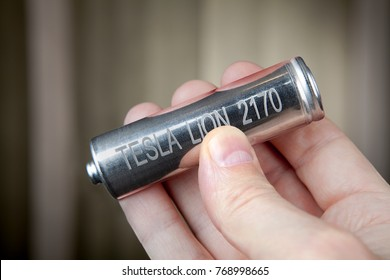 St. Petersburg, Russia - November 30, 2017: A close-up of one cylindrical lithium-ion rechargeable battery for electric cars of Tesla lies in the human palm.