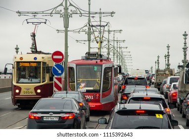ST PETERSBURG, RUSSIA - OCTOBER 10, 2017: Busy traffic with trams and cars jammed on road during rush hour at St. Petersburg, Russia.
