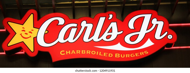 ST. PETERSBURG, RUSSIA - OCTOBER 11, 2018: Carl's Jr. Fast Food Restaurant Logo. Close Up Image of Carl's Jr. Burger Joint Brand Sign. Carl's Jr. is World Famous American Fast Food Restaurant Chain