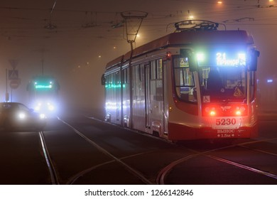 ST. PETERSBURG, RUSSIA - OCTOBER 11, 2018: Modern tram on operation in a misty evening. The city tramway system was the world longest since late 1980s till 2000s, but now has 4th place in the world
