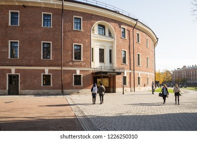"ST. PETERSBURG, RUSSIA - OCTOBER 16, 2018: New Holland. In building of former prison ""Bottle"" after reconstruction there are cafes, restaurants, shops and more"