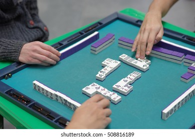 ST. PETERSBURG, RUSSIA - OCTOBER 20, 2016: People play Mahjong during the China Day in Pulkovo airport. The event is organized by the airport administration, and the General Consulate of China