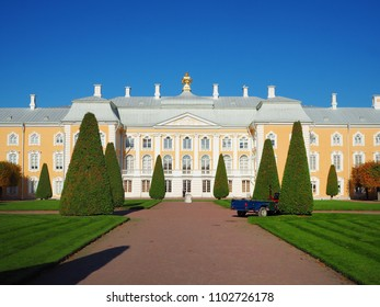 St. Petersburg / Russia - October 3, 2016 : Beautiful scenery in front of Peterhof Palace, UNESCO World Heritage Site with green gardening and blue sky.